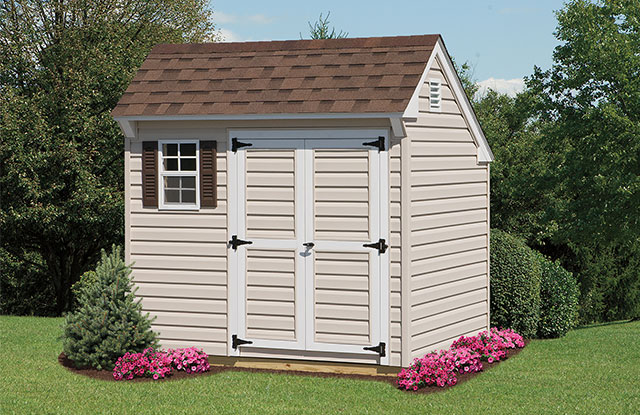 mini quaker shed with brown window shutters and roof in a maryland black yard