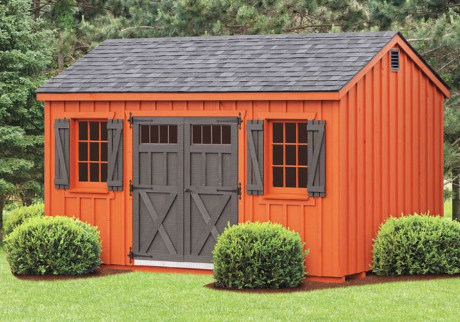 orange and dark grey board and batten shed with double doors in md
