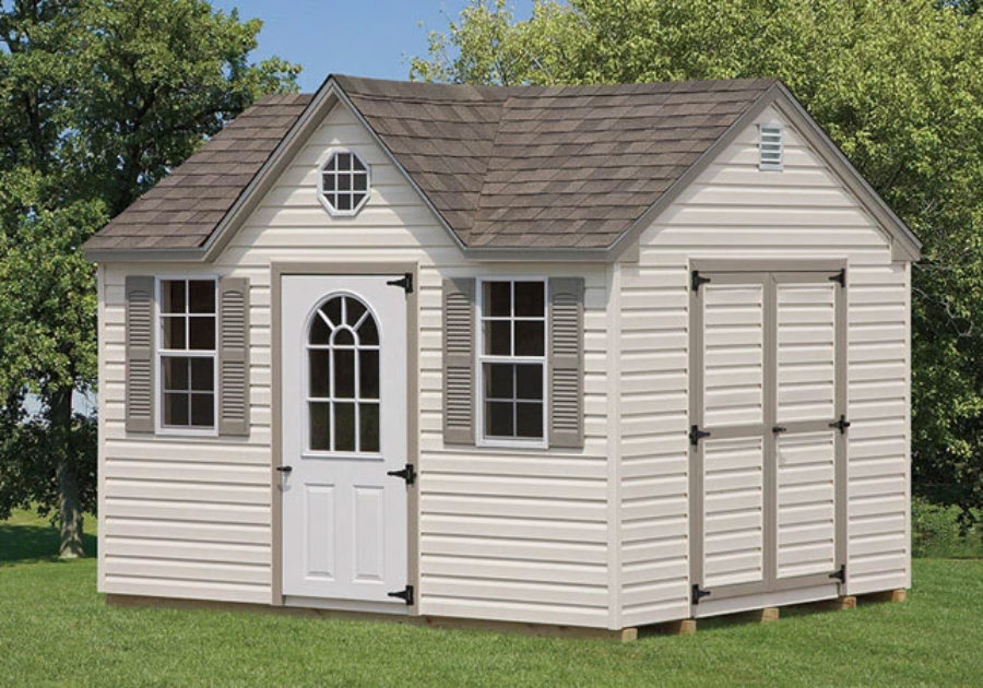 storage shed featuring beige trim and and pointed roof