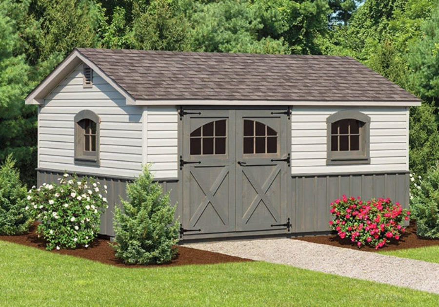 grey storage shed with decorative panel and asphalt roof