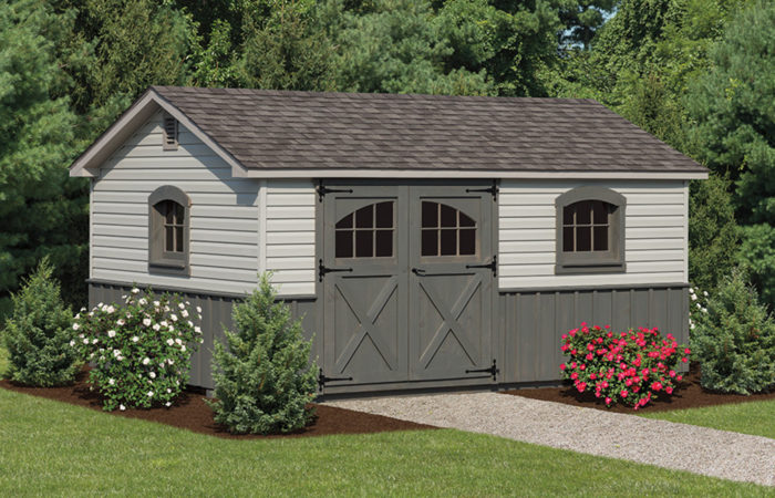 a frame storage shed with olive siding and double doors