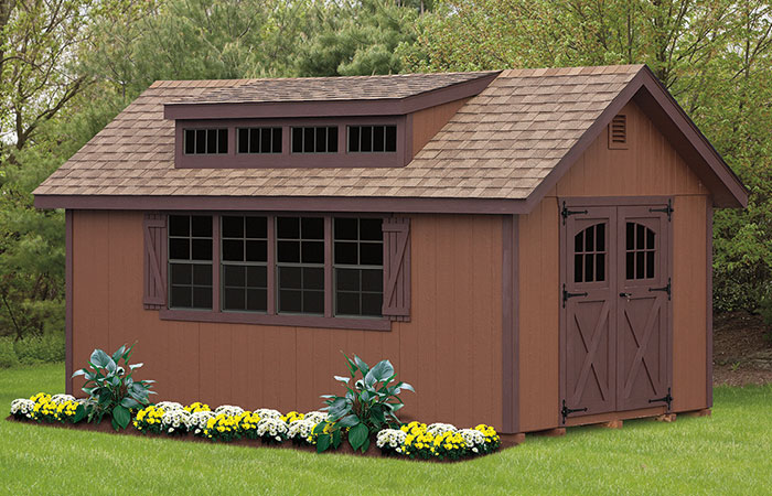 all brown dormer shed with large front windows