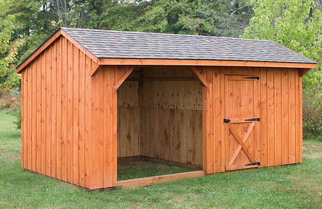 backyard small horse barn with tack area built by amish craftsmen