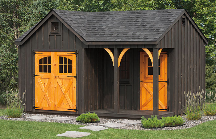 board and batten a frame storage shed with a porch nook in the front