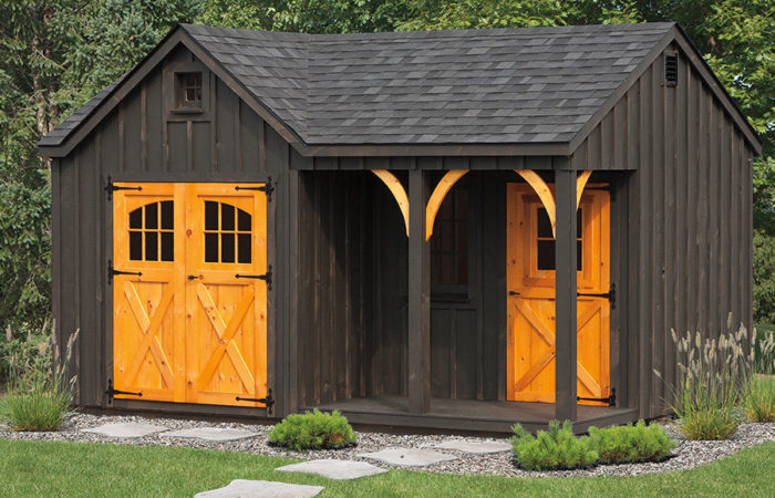 board and batten shed build with natural wood details and small porch