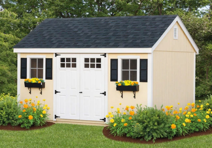 cream a frame shed with white doors and window boxes