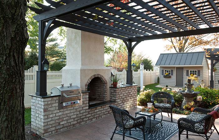 dark grey pergola over backyard patio at md home