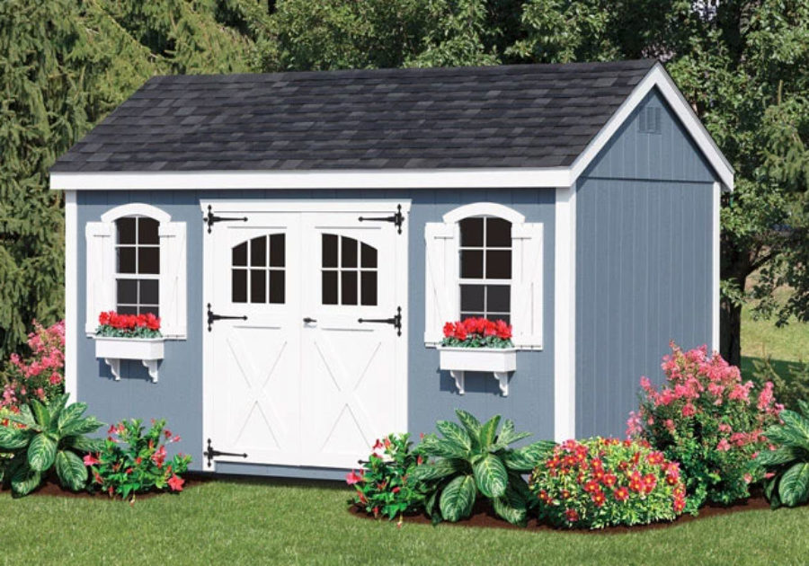 garden shed with blue siding and window boxes
