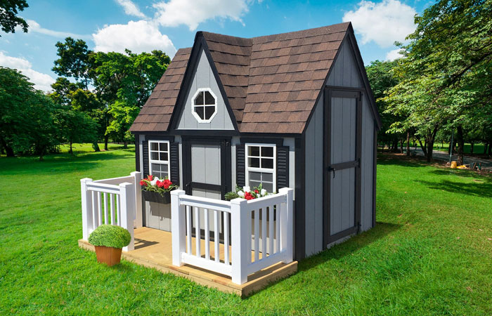 grey victorian backyard playhouse with porch
