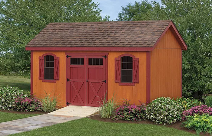 kountry series shed with rustic wooden siding and red trim