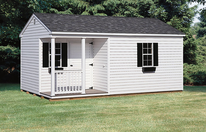 large white vinyl a frame storage shed with a small porch nook in the front