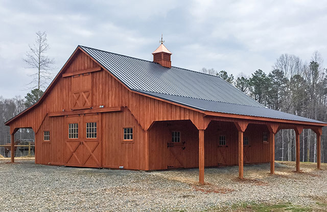 luxury hand built amish horse barn with loft and overhang