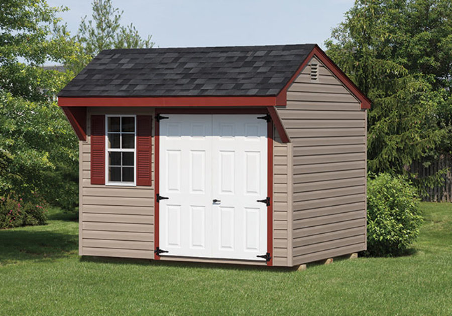 mini quaker series shed with tan siding red trim and white doors