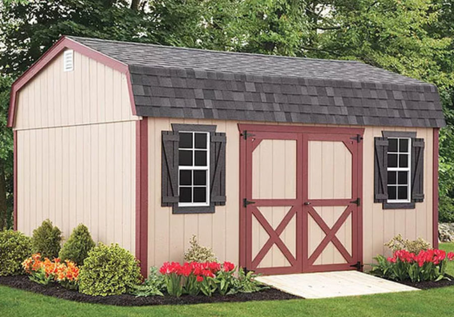 red and tan highwall shed with sloped roof