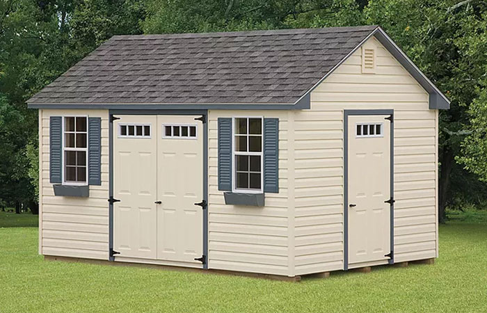 rustic kountry series shed with cream siding and blue shutters