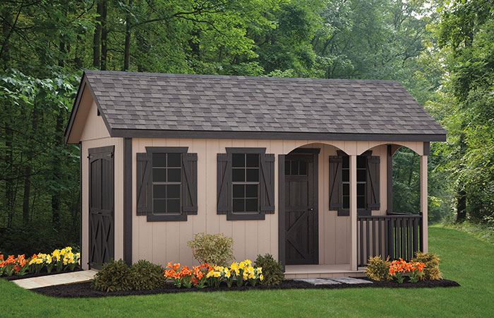 storage shed with a small porch nook out front and workspace inside