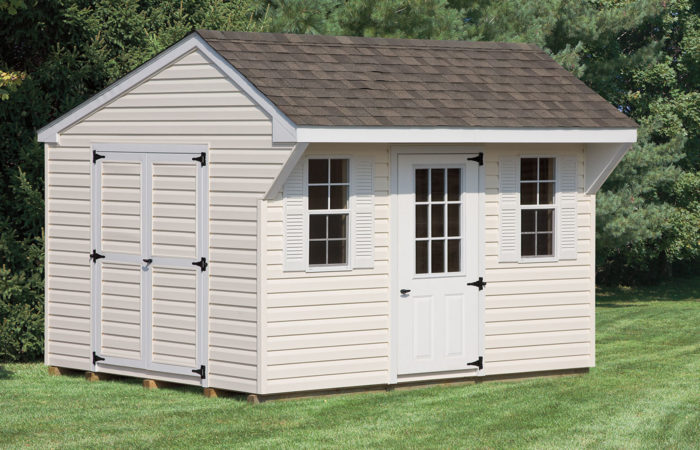cream colored mini quaker style shed with overhang