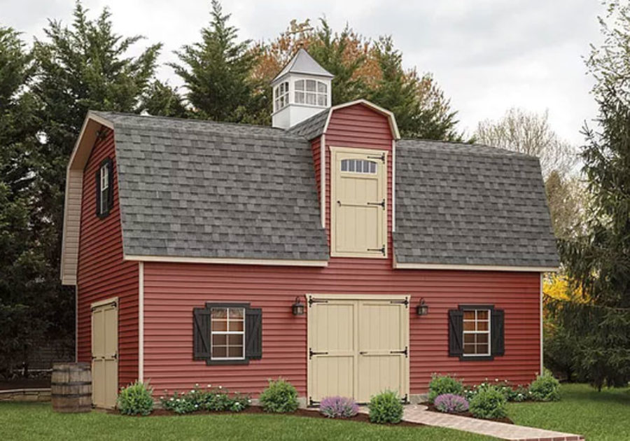 two story shed with gambrel roof and cream colored loft door
