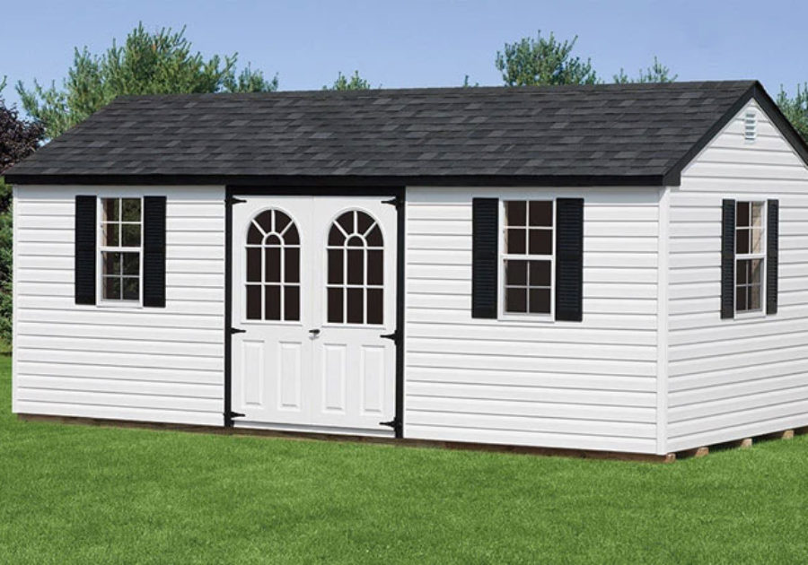 vinyl shed with white siding and black trim with deluxe doors