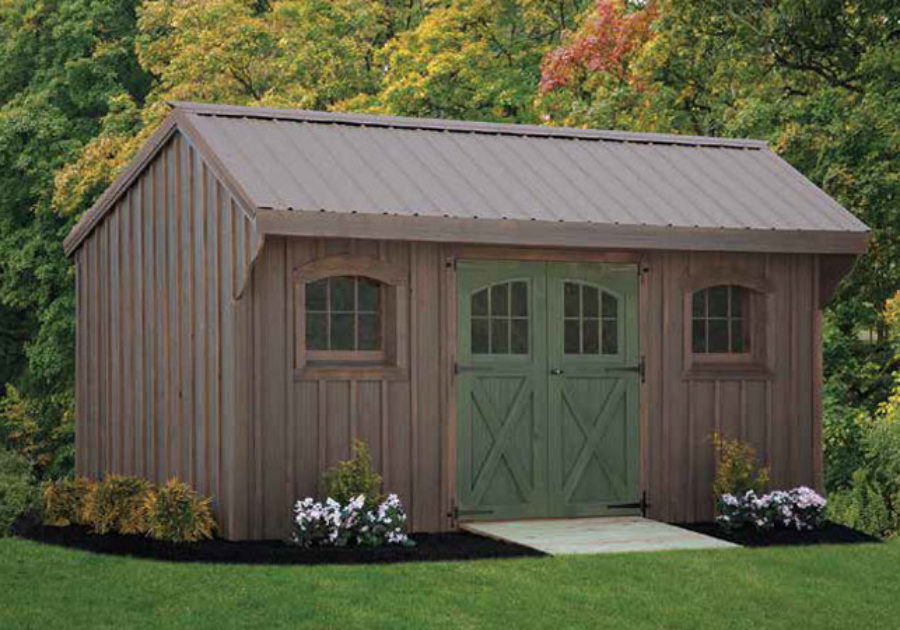 weathered gray quaker series shed with dark green weathered door