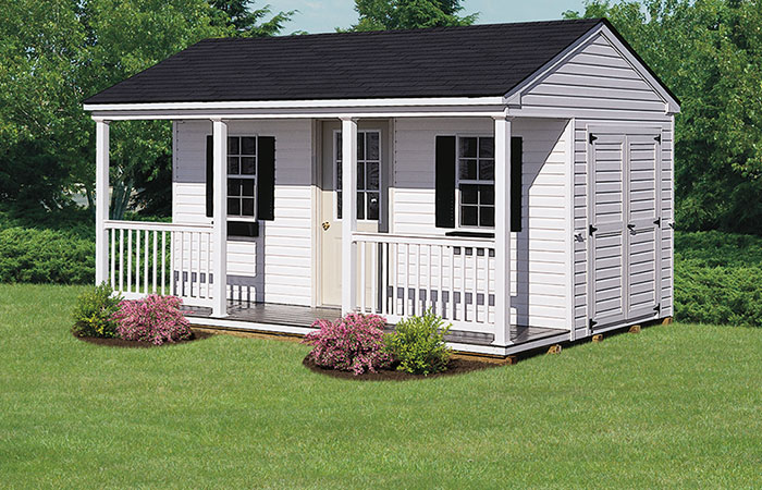 white backyard storage shed with gable porch