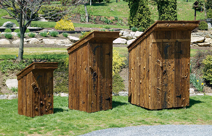 amish built outhouses on display