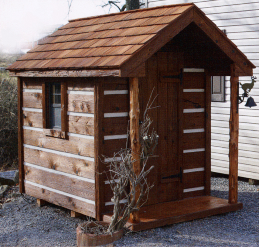 amish built outhouse with porch posts and wood shingles