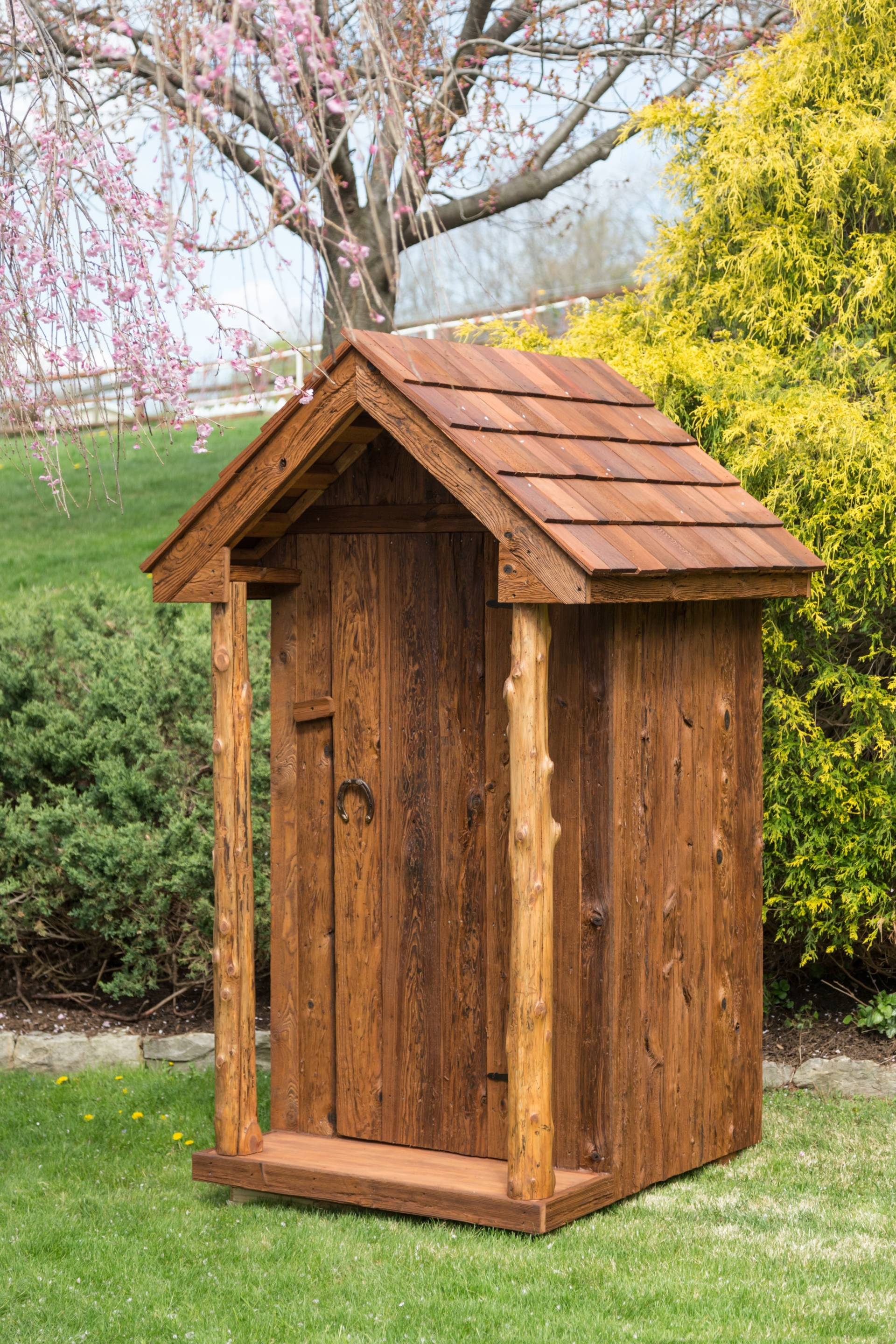amish built outhouse with wooden shingles