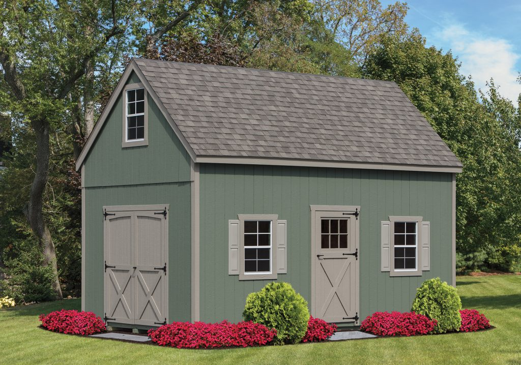 green a frame shed with 2 stories and shingles