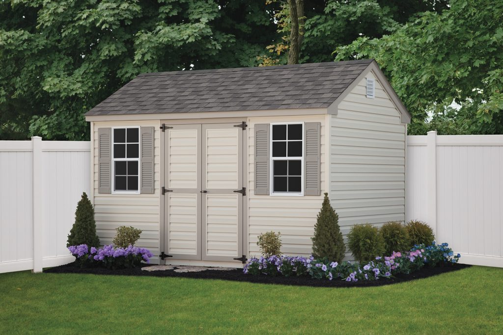 white and beige a frame shed in a garden bed in a maryland backyard